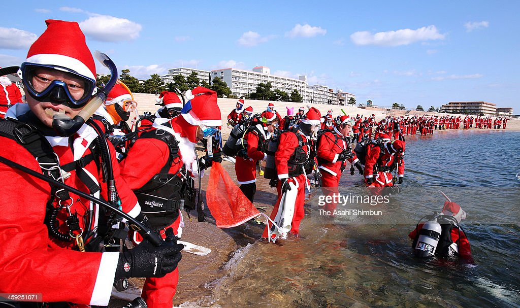 One hundred people dressed as Santa Claus donned diving masks and oxygen tanks on Dec. 23 to clean up trash at the popular Maikonohama beach on December 23, 2013 in Kobe, Hyogo, Japan. The Santas entered the water and held tightly to a rope to stop them from becoming separated as they collected plastic bottles, empty cans and other floating and submerged debris. They traveled back and forth across about 600 square meters of seabed up to 15 meters offshore.
