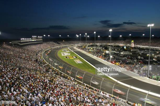 One hundredthousand NASCAR fans enjoy an evening race on a typical oval track May 15 2004 in Richmond Virginia Generally blue collar or middleclass...