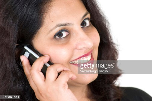 One Indian Business Woman Female talking on phone People Horizon