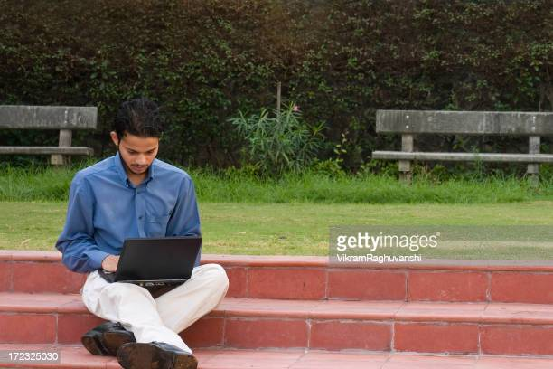 One Indian Businessman working on a laptop Horizontal Garden Sitting