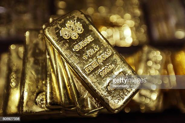 One kilogram gold bars are displayed for a photograph at the YLG Bullion International Co headquarters in Bangkok Thailand on Wednesday Jan 13 2016...