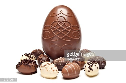 One large chocolate egg surrounded by little chocolate eggs