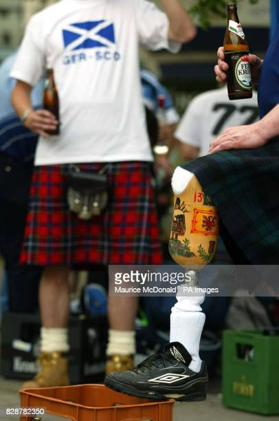 A one legged Scotland fan drinks in the City centre of Dortmund before tomorrow's Euro 2004 Qualifying Match against Germany THIS PICTURE CAN ONLY BE...