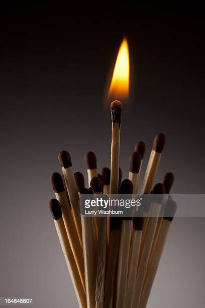 One lit match in bundle of matches