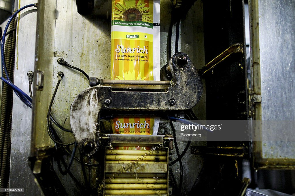 A one liter pack of Ruchi Soya Industries Ltd.'s Sunrich refined sunflower oil is filled and sealed at the company's edible oil refinery plant in Patalganga, India, on Tuesday, June 18, 2013. Monsoon, which accounts for 70 percent of Indias annual rainfall, covered the entire country in a record time, accelerating plantings of crops from rice to soybeans and cotton. Rains covered the whole of India by June 16, the earliest ever and ahead of the normal date of July 15, said D.S. Pai, head of the long-range forecasting division at the India Meteorological Department. Photographer: Dhiraj Singh/Bloomberg via Getty Images