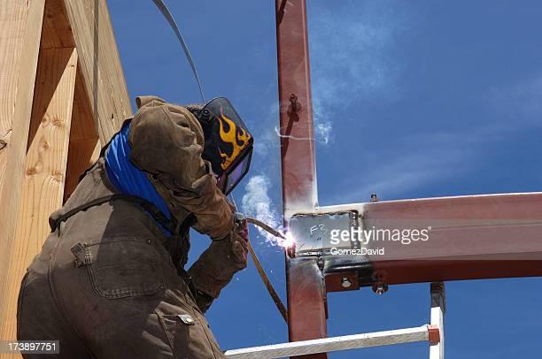 One Male Welder, on Ladder, Working With Steel