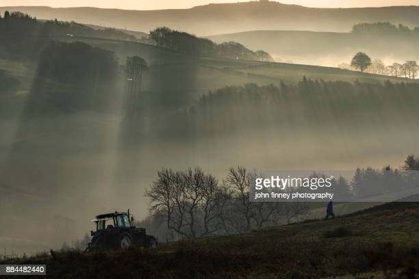 One man and his tractor in the Peak District, Derbyshire, UK