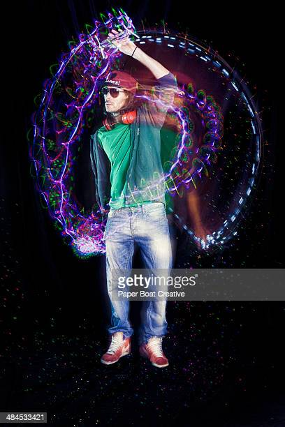 One man dancing with long exposure strobe light