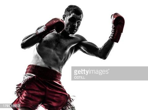 one man exercising thai boxing silhouette : Stock Photo