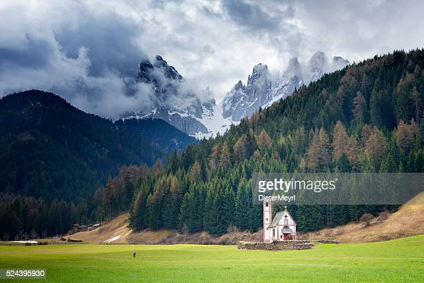 One Man in front of  San Giovanni Church & Dolomites