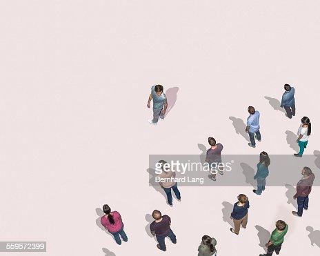 One man looking at crowd behind him, Aerial View