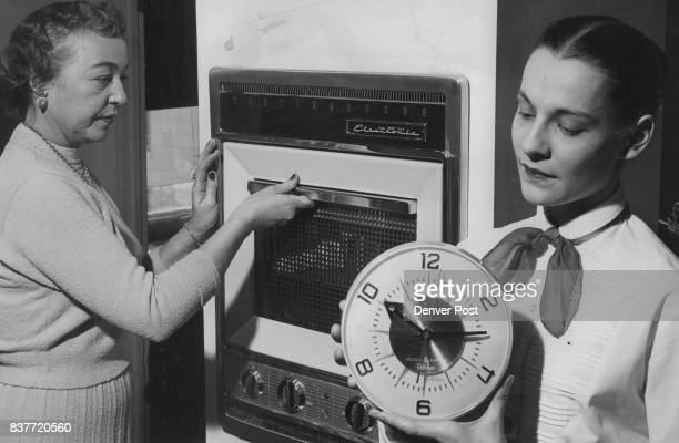 One minute Later Mrs Laird opens door of electronic oven Hotdog is cooked soup is piping hot paper unscorched Credit Denver Post