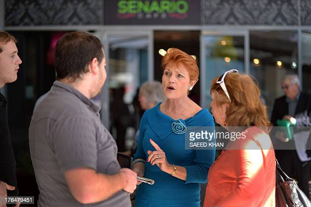 One Nation Party founder and Senate candidate Pauline Hanson campaigns at a shopping arcade in the suburbs of Sydney on August 14 2013 With the...