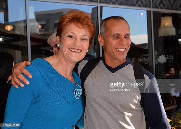 One Nation Party founder and Senate candidate Pauline Hanson poses with a resident as she campaigns at a shopping arcade in the suburbs of Sydney on...