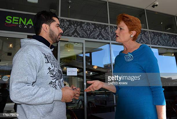One Nation Party founder and Senate candidate Pauline Hanson speaks to a man as she campaigns at a shopping arcade in the suburbs of Sydney on August...