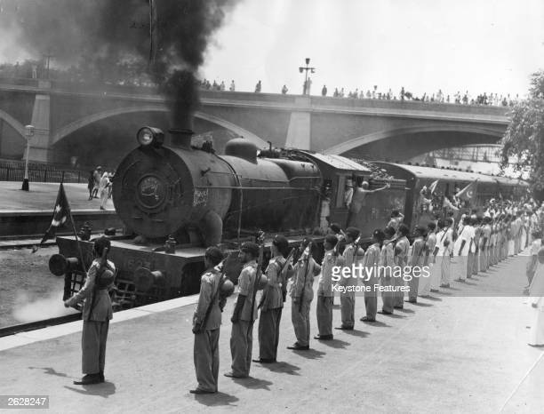One of 30 special trains leaving New Delhi Station which will take the staff of the Pakistan government to Karachi Muslim League National Guards...