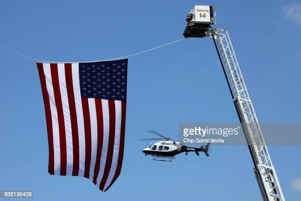 One of a dozen law enforcement helicopters flys over the funeral of TrooperPilot Berke MM Bates at Saint Paul's Baptist Church August 18 2017 in...