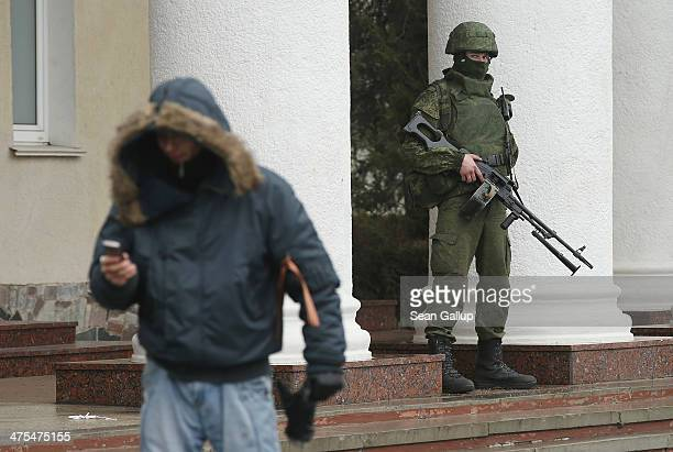 One of approximately 20 soldiers who were wearing no identifying insignia and declined to say whether they were Russian or Ukrainian patrols outside...