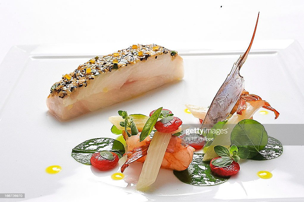 One of Arnaud Donckele's recipes with fresh fish on March 21, 2013 in St Tropez,France. Chef of the restaurant La Vague D'Or in the hotel La Residence de la Pinede who received his 3th etoile from the famous gourmet guide Michelin.