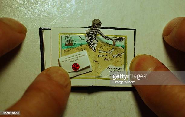8/19/2002 – One of Barbara Raheb's miniature books which has a pop–up character and an envelope containing a map all on two of the pages inside Raheb...