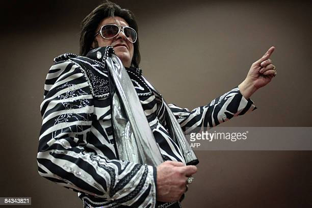 One of five Elvis Presley lookalike 'Zebra' of Hungary prepares for his performance during the Second International Elvis Show in Budapest on Januray...