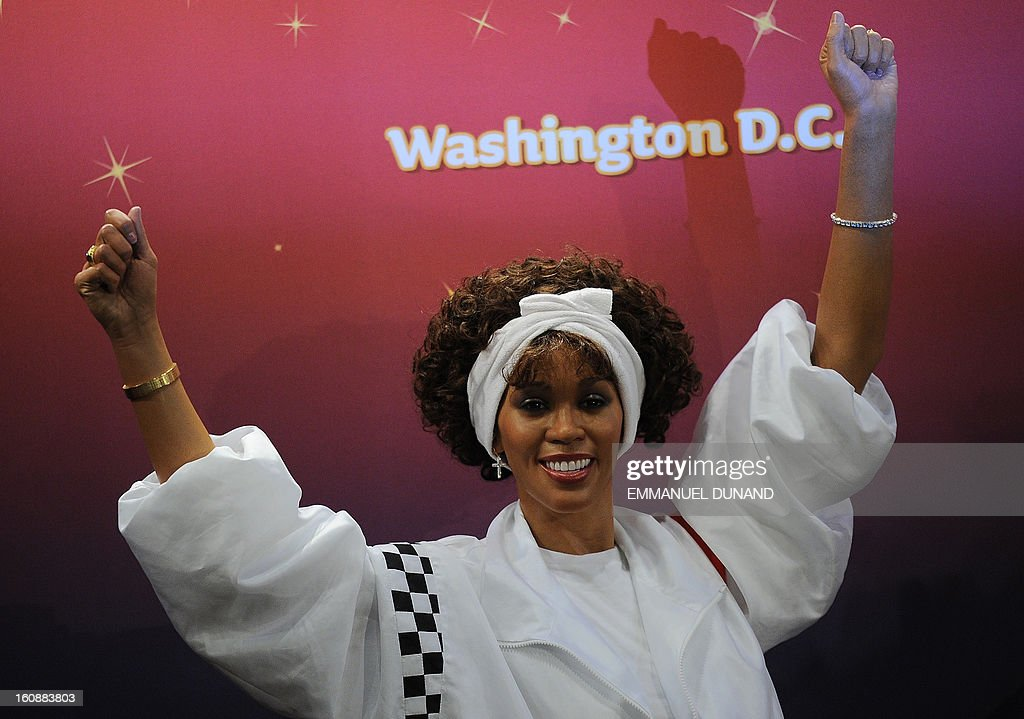 One of four wax figures of late US singer Whitney Houston is unveiled at Madame Tussauds in New York, February 7, 2013. The new wax likenesses, representing Houston in four different points of her life, were unveiled in front of some of her family members before being individually installed in each of the four US-based Madame Tussauds attractions in New York, Washington DC, Los Angeles and Las vegas. AFP PHOTO/Emmanuel Dunand