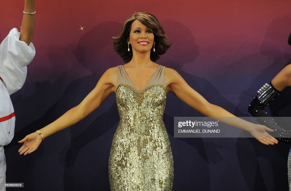 One of four wax figures of late US singer Whitney Houston is unveiled at Madame Tussauds in New York, February 7, 2013. The new wax likenesses, representing oLos Angeles and Las vegas. AFP PHOTO/Emmanuel Dunand