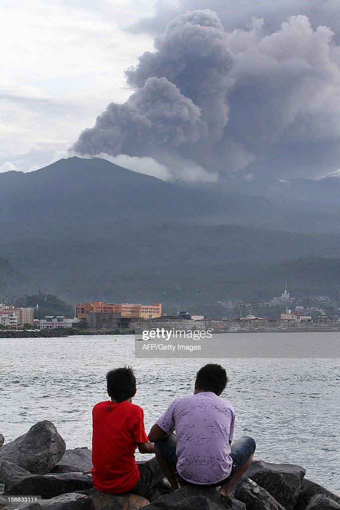 One of Indonesia's most active volcanoes, the 1,580-metre (5,214-feet) high Mount Lokon, spews clouds of ash in Minahasa, on Indonesia's northern Sulawesi island, on December 31, 2012. The Indonesian archipelago has dozens of active volcanoes and straddles major tectonic fault lines known as the 'Ring of Fire' between the Pacific and Indian Oceans.
