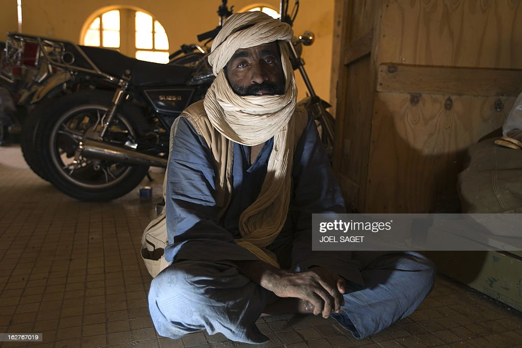 One of nine prisoners, comprising seven Malian, one Nigerois and one Mauritanian, Mohamed Ag Idoual, 55, charged with being a MUJAO commander in the town of Ansongo, 90 kms southeast of Gao, sits in a jail at the gendarmerie in the northern Malian city of Gao on February 26, 2013 before being transferred on a military flight to Bamako, where all suspects are to be judged on charges of belonging to the main Islamist armed group, the Movement for Oneness and Jihad in West Africa (MUJAO), an Al-Qaeda offshoot. French and Malian government forces reconquered on January 26 the city opf Gao, two weeks after Paris launched an offensive in the north.