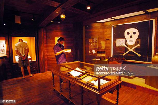 One of only two existing original Jolly Roger pirate flags is displayed in one of the alcoves of the Pirate Soul Museum 10 January 2005 in Key West...