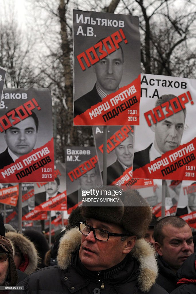 One of Russian opposition leader, former Prime minister Mikhail Kasyanov attends an opposition rally on January 13, 2013 on the Boulevard Ring in the center of Moscow against a Kremlin law that banned US adoptions of Russian orphans. The protest dubbed 'the March Against Scoundrels' was aimed at naming and shaming the lawmakers who fast-tracked the anti-adoption bill through the lower house parliament, the State Duma. At least 20,000 Russian opposition supporters take part of this rally.