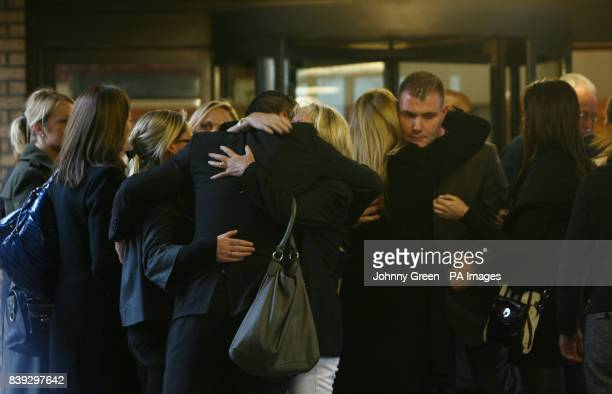 One of Sandra Simpson's sons Darren Simpson is comforted by members of his family following the sentencing of former Metropolitan police officer...