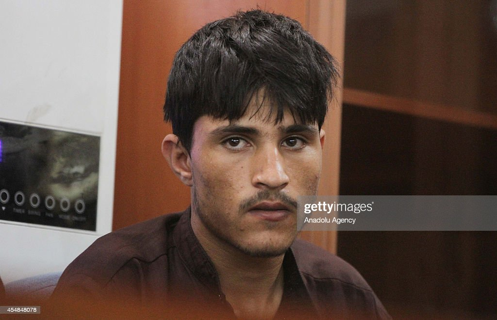 One of seven men who gangraped four women on August 23 stands in court in Kabul Afghanistan on September 7 2014 Afghanistan handed the death penalty...