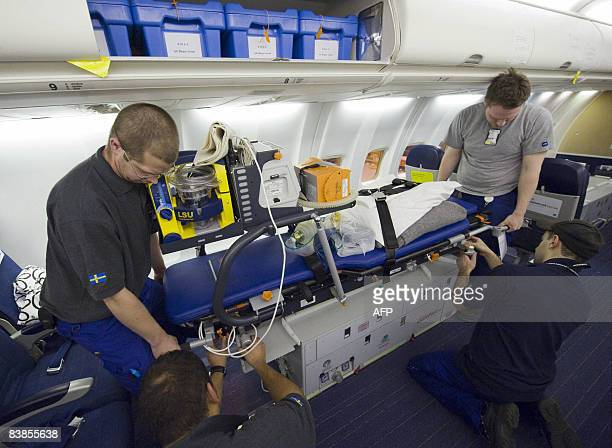 One of six intensive care units from the SNAM is mounted inside an SAS Boeing 737800 passenger jet converted into an advanced ambulance aircraft at...