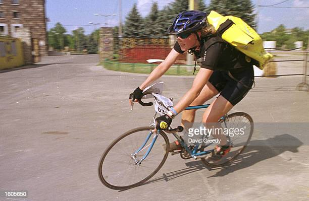 One of the 53 women cycle messengers rounds a corner during the final race of the 9th Annual Cycle Messenger''s World Championships July 29 2001 in...