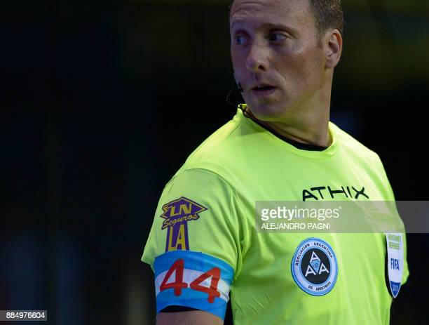 One of the assistants of referee Facundo Tello wears an armband with the colors of the Argentine flag and the number '44' in homage to the 44 crew...