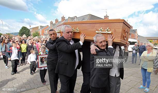 One of the 'Birmingham Six' Paddy Hill helps carry the coffin of Gerry Conlon from his home in west Belfast on June 28 2014 Conlon who wrongly spent...