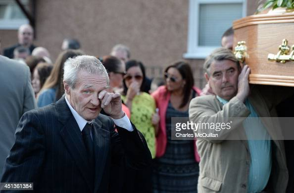 One of the Birmingham Six Paddy Hill wipes a tear as the coffin of Gerry Conlon is carried into St Peter's Cathedral for a requiem mass on June 28...