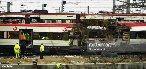 One of the bomb damaged trains is towed past another at Atocha train station on March 12 2004 in Madrid Spain According to judicial sources 198...
