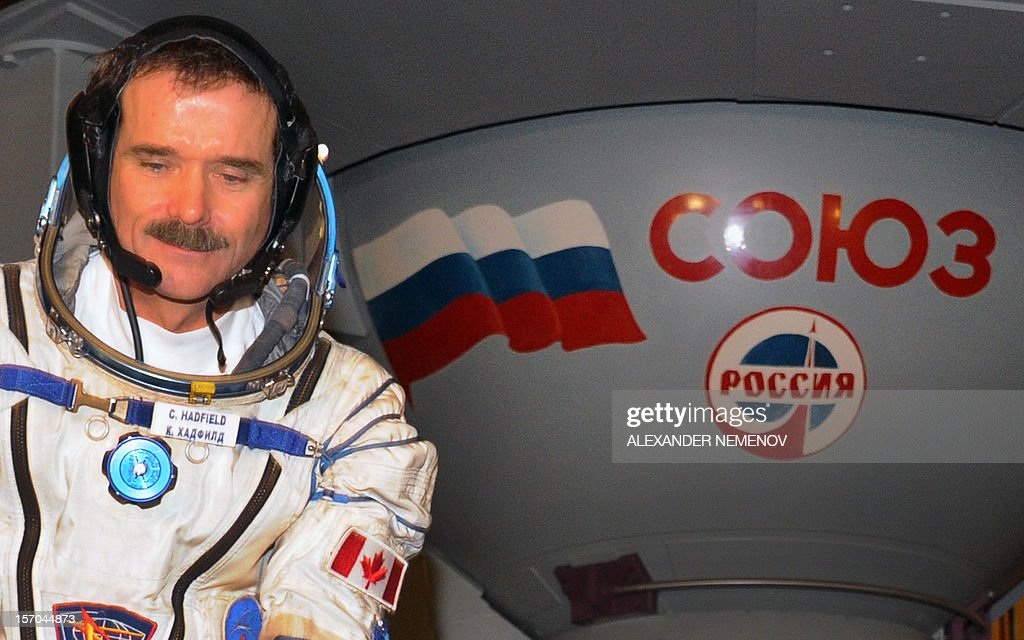 One of the crew members of the next expedition to the International Space Station, Canadian astronaut Chris Hadfield, sits in front of a mock-up of a Soyuz TMA space craft during his pre-flight preparation at the Cosmonaut Training Centre in Star City, outside Moscow, on November 28, 2012. Hadfield together with his cremates, Russian cosmonaut Roman Romanenkoand US astronaut Tom Marshburn, will join in December the remaining ISS crew, Russians Oleg Novitskiy and Evgeny Tarelkin, and Kevin Ford of the United States, who arrived there last month.