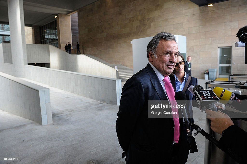 One of the defense lawyers of Raffaele Sollecito, Luca Maori, talks to the media at the new Courthouse during a time break of the appeal trial of Amanda Knox and Raffaele Sollecito on September 30, 2013 in Florence, Italy. Both Knox and Sollecito had the convictions overturned and were released in 2011 after four years in prison. Knox has no plans to return to Italy for the retrial and will be represented by her laywers in court.