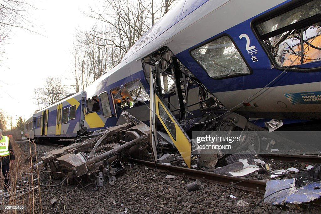 One of the destroyed trains is seen at the site of a train accident near Bad Aibling, southern Germany, on February 9, 2016. Two Meridian commuter trains operated by Transdev collided head-on near Bad Aibling, around 60 kilometres (40 miles) southeast of Munich, killing at least eight people and injuring around 100, police said. The cause of the accident was not immediately clear. / AFP / dpa / Josef Reisner / Germany OUT