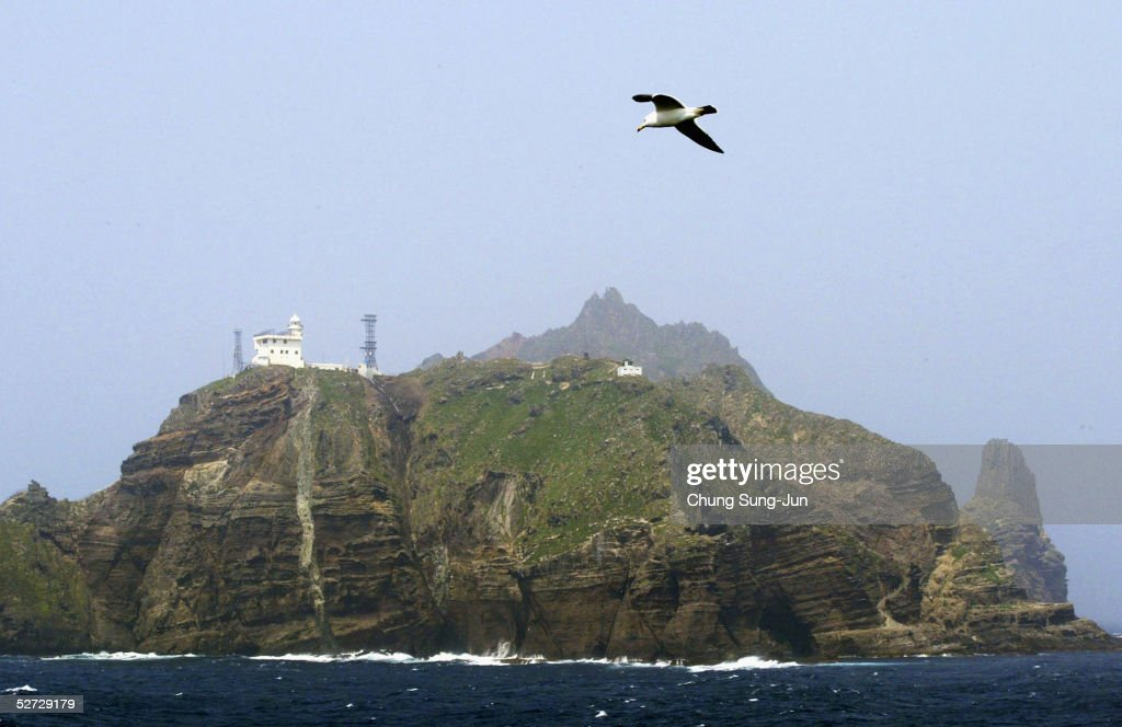 One of the Dokdo Islets, known by the Japanese as the Takeshima Islands, is seen from a South Korean coast guard ship as it sails close to the disputed islets April 28, 2005 90 kilometres east of the South Korean Ullung Island. The volcanic islets have been a source of diplomatic tension betweem Seoul and Tokyo for years leading to violent anti-Japanese demonstrations breaking out in South Korea in recent weeks.