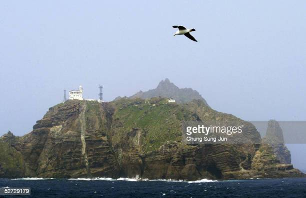One of the Dokdo Islets known by the Japanese as the Takeshima Islands is seen from a South Korean coast guard ship as it sails close to the disputed...