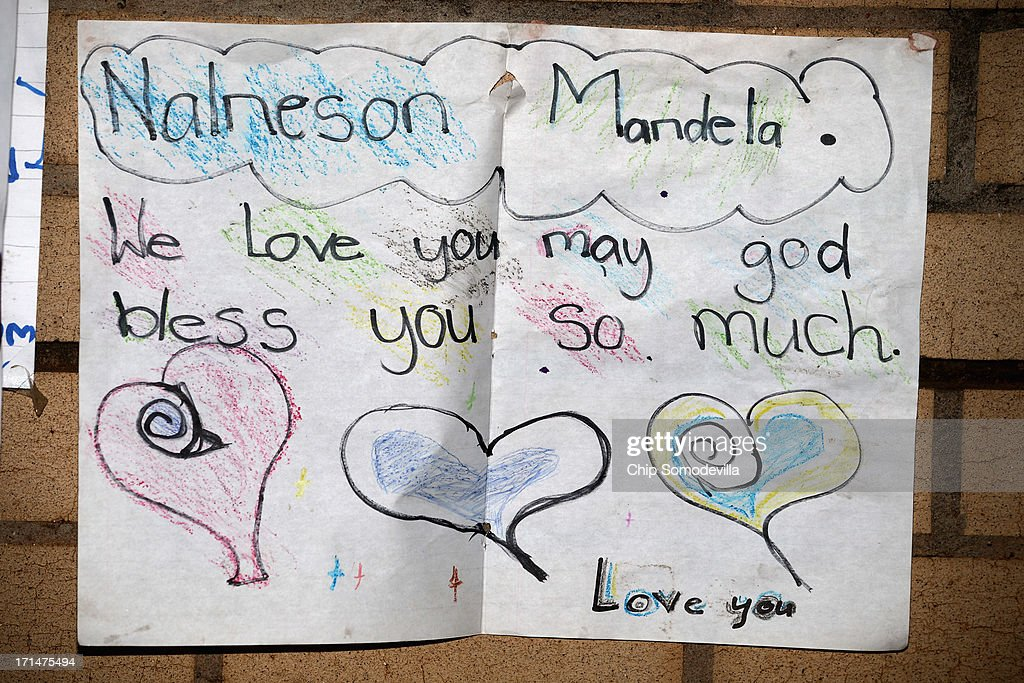 One of the dozens of hand-made messages of support for former South African President Nelson Mandela posted to the wall outside the Mediclinic Heart Hospital June 25, 2013 in Pretoria, South Africa. South African President Jacob Zuma confirmed Sunday that Mandela's condition has become critical since he was admitted to the hospital over two weeks ago for a recurring lung infection.