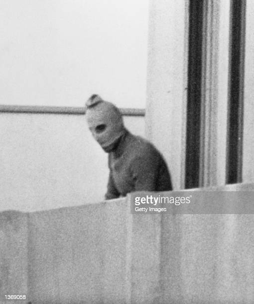 One of the eight Palestinian terrorists comprising the Black September group stands on a balcony of the Olympic village during a standoff after they...