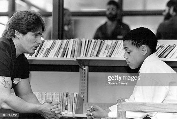 MAY 30 1989 One of the eight teenagers from Northeast Denver listens to a convict from the Arkansas Valley Prison near ***** way Colo during a prison...