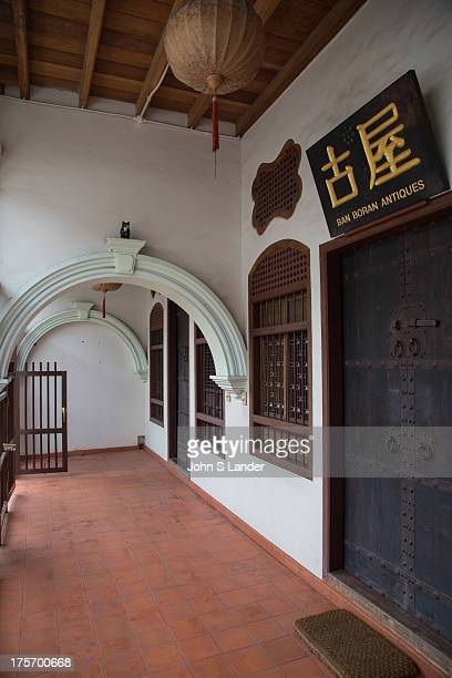 One of the features of Phuket shophouses or 'row houses' is the front verandahs form a sheltered walkway and intricate stucco designs often grace...