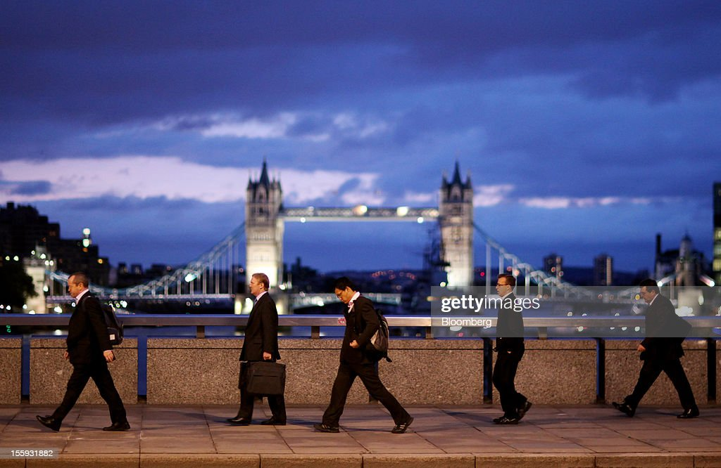 EDITORS' GUILD AWARDS 2012. One of the five photographs by Bloomberg photographer Chris Ratcliffe shortlisted for the 'Bloomberg Business Photographer of the Year' category in the 2012 awards. Picture Shows: Pedestrians walk across London Bridge towards the City financial district in London, U.K., on Tuesday, Oct. 11, 2011. Photographer: Chris Ratcliffe/Bloomberg via Getty Images