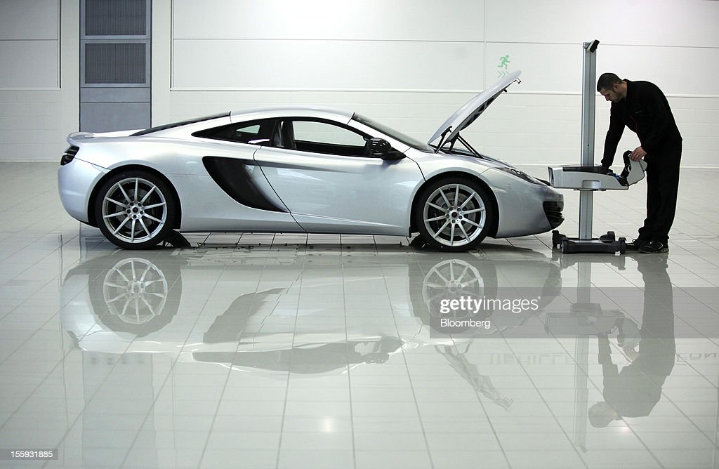 EDITORS' GUILD AWARDS 2012. One of the five photographs by Bloomberg photographer Chris Ratcliffe shortlisted for the 'Bloomberg Business Photographer of the Year' category in the 2012 awards. Picture Shows: An employee prepares a McLaren MP4-12C supercar for quality control testing at the company's factory in Woking, U.K., on Wednesday, April 11, 2012. Photographer: Chris Ratcliffe/Bloomberg via Getty Images